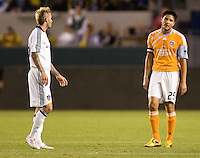 Houston Dynamo forward Brian Ching avoiding  LA Galaxy midfielder David Beckham during the Western Conference Final. The LA Galaxy defeated the Houston Dynamo 2-1 to win the MLS Western Conference Final at Home Depot Center stadium in Carson, California on Friday November 13, 2009.....