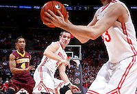 Ohio State Buckeyes guard Aaron Craft (4) moves back to position after dishing a pass to Ohio State Buckeyes guard Amedeo Della Valle (33) during the first half of the NCAA men's basketball game between the Ohio State Buckeyes and the Minnesota Golden Gophers at Value City Arena in Columbus, Ohio, on Saturday, Feb. 22, 2014. At the end of the first half, Minnesota led Ohio State, 28-18. (Columbus Dispatch/Sam Greene)