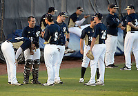 Florida International University team relaxes before the game against Florida Atlantic University. FAU won the game 5-1 on March 16, 2012 at Miami, Florida.