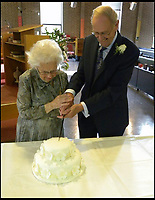 BNPS.co.uk (01202 558833)<br /> Pic: AnthonyOliver/BNPS<br /> <br /> Newlyweds Margaret(92) and Rob (91) cutting the cake.<br /> <br /> A couple with a combined age of 183 have tied the knot to become Britain's oldest newlyweds.<br /> <br /> Rob Cave, 91, and 92-year-old Margaret James, a former actress who appeared in the classic romance film Brief Encounter, wed in front of 150 friends and family at Wimborne Minster in Dorset.<br /> <br /> The church-going couple have known each other for over 30 years but became an item after their respective spouses died within three months of each other in 2015.<br /> <br /> They consoled each other to begin with and from seeing each other every day, their friendship developed into a romance.