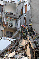 Soldiers rescue a woman, Cha Guiying, 41 from the rubble of her apartment block in Dujiangyan, China..14 May 2008