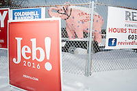 A sign for Republican presidential candidate Jeb Bush stands near a fence near a large pink elephant in Derry, New Hampshire, on Tues., Feb. 10, 2016.