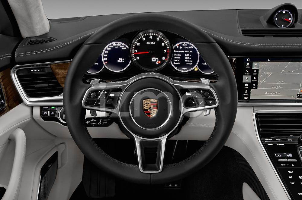 Car pictures of steering wheel view of a 2017 Porsche Panamera Turbo 5 Door Hatchback Steering Wheel