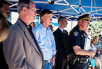 From left, Aurora Mayor Steve Hogan (cq), Colorado Governor John Hickenlooper (cq) and Aurora Police Chief Dan Oates (cq, far right) during a press conference at the Aurora Municipal Center Saturday, July 21, 2012 regarding the mass shootings from the Aurora Century 16 movie theater in Aurora, Colorado. The shootings occurred during the midnight premiere of the new Dark Knight Batman movie...Photo by MATT NAGER