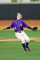 Western Carolina Catamounts second baseman Bradley Strong (1) tracks a fly ball in shallow right field against the Wake Forest Demon Deacons at Wake Forest Baseball Park on March 26, 2013 in Winston-Salem, North Carolina.  The Demon Deacons defeated the Catamounts 3-1.  (Brian Westerholt/Four Seam Images)
