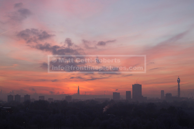 12/12/2012. London, UK.  The London skyline is seen at dawn through a freezing winter mist from Primrose Hill in North London. Photo credit: Matt Cetti-Roberts