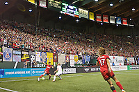 Portland, Oregon - Sunday September 11, 2016: Portland Thorns FC defender Meghan Klingenberg (25) dribbles the ball in front of a sellout crowd during a regular season National Women's Soccer League (NWSL) match at Providence Park.