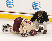 Bill Arnold (BC - 24), Bert Lenz (BC - Director, Sports Medicine) - The Boston College Eagles defeated the visiting University of Vermont Catamounts to sweep their quarterfinal matchup on Saturday, March 16, 2013, at Kelley Rink in Conte Forum in Chestnut Hill, Massachusetts.