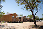 Groups of small temporary houses like these in Crystal City, Texas have cropped up in south Texas to accomodate the influx of oil field workers. October 2, 2012. Copyright Lance Rosenfield/Prime