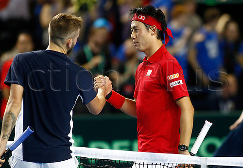 04.03.2016. Barclaycard Arena, Birmingham, England. Davis Cup Tennis World Group First Round. Great Britain versus Japan. Kei Nishikori consoles Dan Evans at the end of their match.  Nishikori won in straight sets 6-3, 7-5, 7-6.