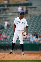NW Arkansas Naturals pitcher Aroni Nina (16) looks in for the sign during a game against the San Antonio Missions on May 31, 2015 at Arvest Ballpark in Springdale, Arkansas.  NW Arkansas defeated San Antonio 3-1.  (Mike Janes/Four Seam Images)
