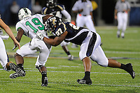 14 November 2009:  FIU FB John Ellis (27) tackles North Texas wide receiver Darius Carey (19) in the first half as the FIU Golden Panthers defeated the North Texas Mean Green, 35-28, at FIU Stadium in Miami, Florida.