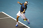BANGKOK, THAILAND - SEPTEMBER 30:  Ruben Bemelmans of Belgium returns a ball against Rafael Nadal of Spain during the Day 6 of the PTT Thailand Open at Impact Arena on September 30, 2010 in Bangkok, Thailand. Photo by Victor Fraile / The Power of Sport Images
