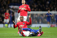 Manchester United recent signing, Odion Ighalo looks at the assistant referee after being pinned to the ground by Chelsea's Antonio Rudiger during Chelsea vs Manchester United, Premier League Football at Stamford Bridge on 17th February 2020