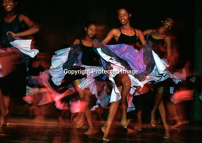 "Dance students in the ""Dance for all"" programme on November 25, 2000 dancing at a yearly performance in Guguletu, South Africa. The programme was started by the Cape Town city ballet in the poor and destitue squatter camps nine years ago. About 200  kids aged from 6-18 are dancing 3 times a week and finding something meaningful to do after school. .Photo: Per-Anders Pettersson (ppettersso@aol.com)"
