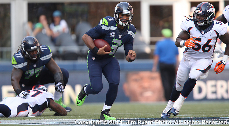 Seattle Seahawks quarterback Russell Wilson (3) scrambles away from the Denver Broncos  linebacker Nate Irving (56) at CenturyLink Field in Seattle, Washington on September 21, 2014.  Wilson completed 24 of 34 passes for 258 yards, two touchdowns and one interception in the 26-20 overtime win against the Broncos.  ©2014. Jim Bryant Photo. All rights Reserved.