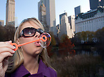 Young Woman Playing with Bubbles in Cental Park NYC