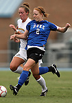 28 August 2009: Duke's Rebecca Allen (2) and Greensboro's Casey Godwin (behind). The Duke University Blue Devils lost 1-0 to the University of North Carolina Greensboro Spartans at Fetzer Field in Chapel Hill, North Carolina in an NCAA Division I Women's college soccer game.
