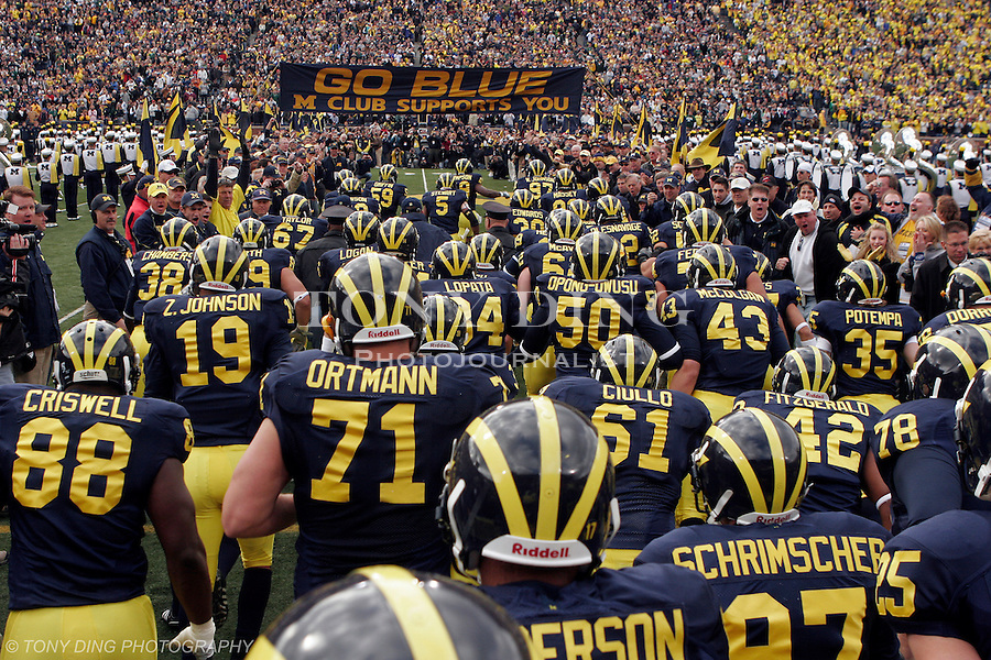25 October 2008: The Michigan football team takes the field, cheered on by past alumni players, before an NCAA college football game between the Michigan Wolverines and the Michigan State Spartans, at Michigan Stadium in Ann Arbor, Michigan.