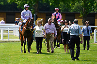 Edged Out ridden by Mitch Goodwin is led into the winners enclosure after winning The Think Cars Ssangyong Paddock Area Display Handicap, during Father's Day Racing at Salisbury Racecourse on 18th June 2017