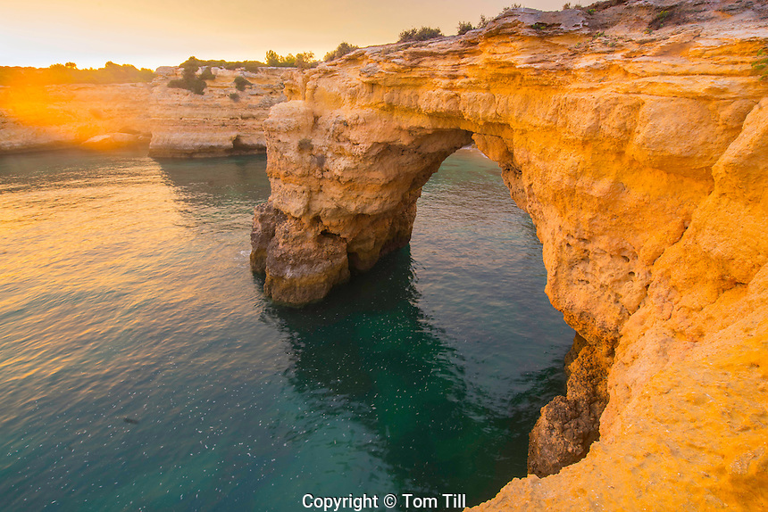 Sea arch at sunrise on Algrave Coast, Portugal, Atlantic Ocean   Near Lagoa