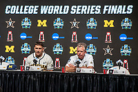 Michigan Wolverines head coach Erik Bakich and Vanderbilt head coach Tim Corbin answer questions during the NCAA College World Series Finals press conference on June 23, 2019 at TD Ameritrade Park in Omaha, Nebraska. Michigan will play Vanderbilt in the CWS Finals. (Andrew Woolley/Four Seam Images)