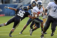 12 August 2011:  FIU's Jeremiah Harden (6) attempts to evade Christopher Edwards (56) during a scrimmage held as part of the FIU 2011 Panther Preview at University Park Stadium in Miami, Florida.