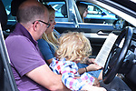 Pictured:  Parishioners of St Barnabas Church, take part in the unique drive-in service, which began at 10am in Swanmore, Hants.<br /> <br /> A church today hosted its first ever drive-in service, with a vicar leading the event from a car park.  Around 40 cars full of worshipers gathered outside a village hall to hear music and listen to the words of the minister.<br /> <br /> Everyone in the vehicles put their driver side window down, so they could join in with the singing, but left the passenger window up to help with social distancing.  People put their hands through the sunroof of their cars and clapped along while reading from hymn sheets provided by the church.  SEE OUR COPY FOR DETAILS.<br /> <br /> © Simon Czapp/Solent News & Photo Agency<br /> UK +44 (0) 2380 458800
