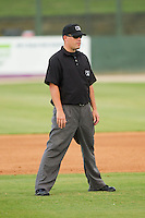 Umpire Cody Oakes handles the calls on the bases during the South Atlantic League game between the Greenville Drive and the Kannapolis Intimidators at CMC-Northeast Stadium on June 29, 2013 in Kannapolis, North Carolina.  The Intimidators defeated the Drive 9-3 in the completion of the game that began on June 28, 2013.   (Brian Westerholt/Four Seam Images)