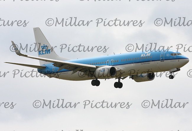 A KLM - Royal Dutch Airlines Boeing 737-8K2 Registration PH-BXB landing at London Heathrow Airport on 29.5.11.