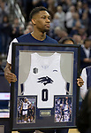 Nevada's Tre'Shawn Thurman (0) holds his framed jersey  on during senior night before an NCAA college basketball game against San Diego State in Reno, Nev., Saturday, March 9, 2019. (AP Photo/Tom R. Smedes)