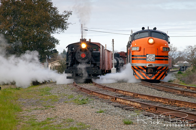 Niles Canyon Railways' steam engine Quincy Railroad Company No. 2, an ALCO 2-6-2T built in 1924, and the Western Pacific 918-D, a 1950 built General Motors EMD F-7 Diesel share the tracks at Vallejo Mills near Sunol, California.