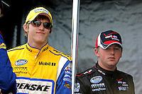 Oct. 3, 2009; Kansas City, KS, USA; NASCAR Nationwide Series driver Parker Kligerman (left) with teammate Justin Allgaier during the Kansas Lottery 300 at Kansas Speedway. Mandatory Credit: Mark J. Rebilas-