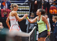 April 18, 2015, Netherlands, Den Bosch, Maaspoort, Fedcup Netherlands-Australia,   Casey Dellacqua (AUS) (R) is being gongratulated by Arantxa Rus<br /> Photo: Tennisimages/Henk Koster