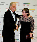 David Letterman and his wife, Regina, clown for the photographers as they arrive for the formal Artist's Dinner honoring the recipients of the 2012 Kennedy Center Honors hosted by United States Secretary of State Hillary Rodham Clinton at the U.S. Department of State in Washington, D.C. on Saturday, December 1, 2012. The 2012 honorees are Buddy Guy, actor Dustin Hoffman, late-night host David Letterman, dancer Natalia Makarova, and the British rock band Led Zeppelin (Robert Plant, Jimmy Page, and John Paul Jones)..Credit: Ron Sachs / CNP