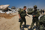Avi Bieber, center, an Israeli soldier, refuses a command to participate in the demolition of houses, at the Israeli settlement bloc of Gush Katif, Gaza Strip.<br /> Israeli army demolished a row of old Egyptian houses, to prevent their renovation by hardline Israeli settlers who recently moved-in to Gush Katif in order to resist Israel's upcoming pullout from Gaza.
