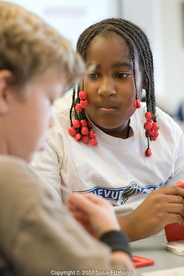 At Graham Hill Elementary School, 4th and 5th graders work together and play math games to learn better how to make the best use of their hand-held calculators.
