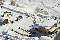Aerial of Sled Dog Team Arriving @ Takotna Chkpt 2005 Iditarod