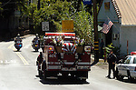 September 20, 2004 Angels Camp, California --Tuolumne Fire –- CDF Engine 4474 with fallen firefighter Eva Marie Schicke's casket goes through Angels Camp on way to her memorial service held at the Calaveras County Fairgrounds.  The Tuolumne Fire was a small very fast-moving fire that started around noon on September 12, 2004 near Lumsden Bridge at the bottom of the Tuolumne River.  The fire moved rapidly up the 80-plus-degree slope catching Cal Fire Helitack firefighters, tragically killing firefighter Eva Marie Schicke and injuring five others.