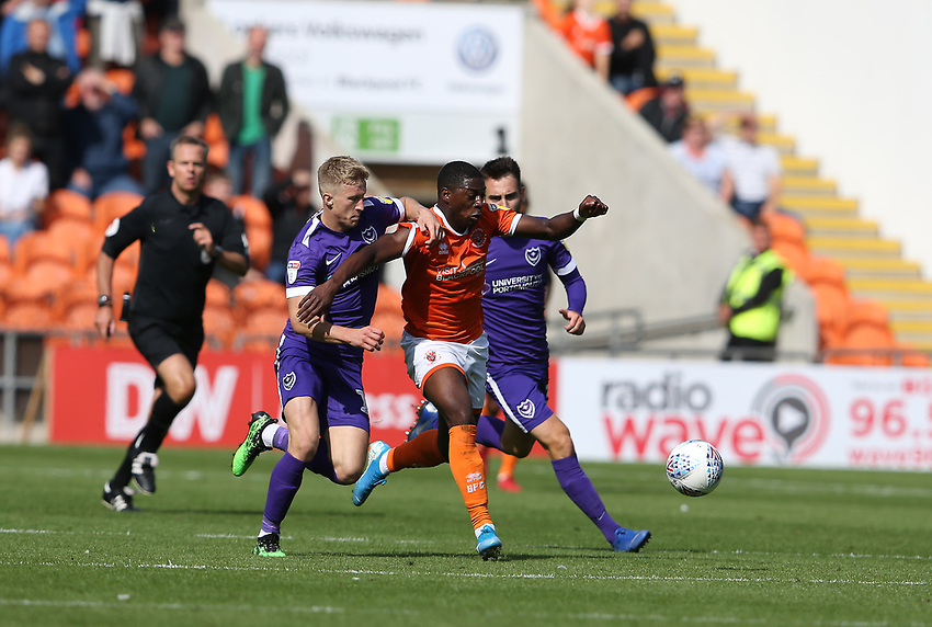 Portsmouth's Ross McCrorie is shown a yellow card for this tackle on Blackpool's Sullay Kaikai<br /> <br /> Photographer Stephen White/CameraSport<br /> <br /> The EFL Sky Bet League One - Blackpool v Portsmouth - Saturday 31st August 2019 - Bloomfield Road - Blackpool<br /> <br /> World Copyright © 2019 CameraSport. All rights reserved. 43 Linden Ave. Countesthorpe. Leicester. England. LE8 5PG - Tel: +44 (0) 116 277 4147 - admin@camerasport.com - www.camerasport.com
