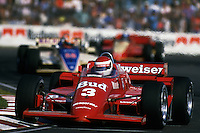 MIAMI, FL - NOVEMBER 9: Bobby Rahal leads a group of cars in his March 85C/Cosworth during the Miami Indy Challenge CART IndyCar race on November 9, 1985, at Tamiami Park in Miami, Florida.