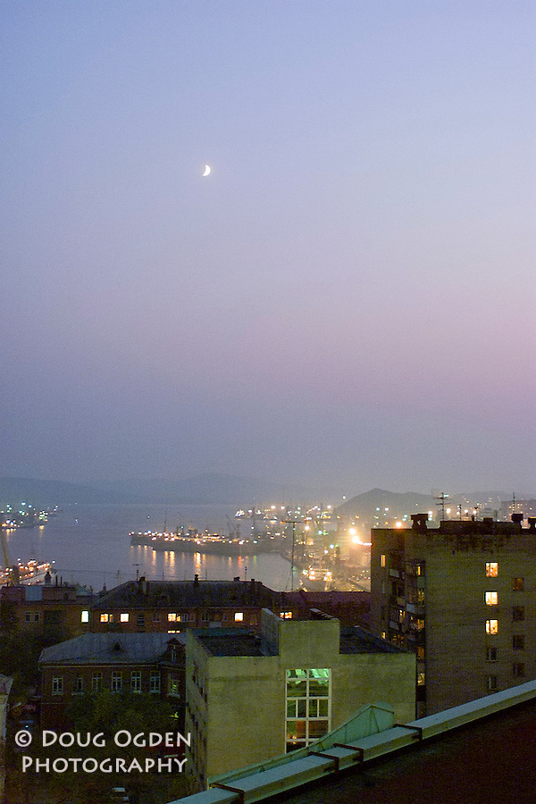 Sunset over Bukhta Zolotoy Rog or Golden Horn Bay, with a half moon, Vladivostok, Russia
