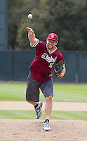 STANFORD, CA - March 11, 2012:  Stanford's Andrew Luck throws the first pitch at the baseball vs Rice at Sunken Diamond.