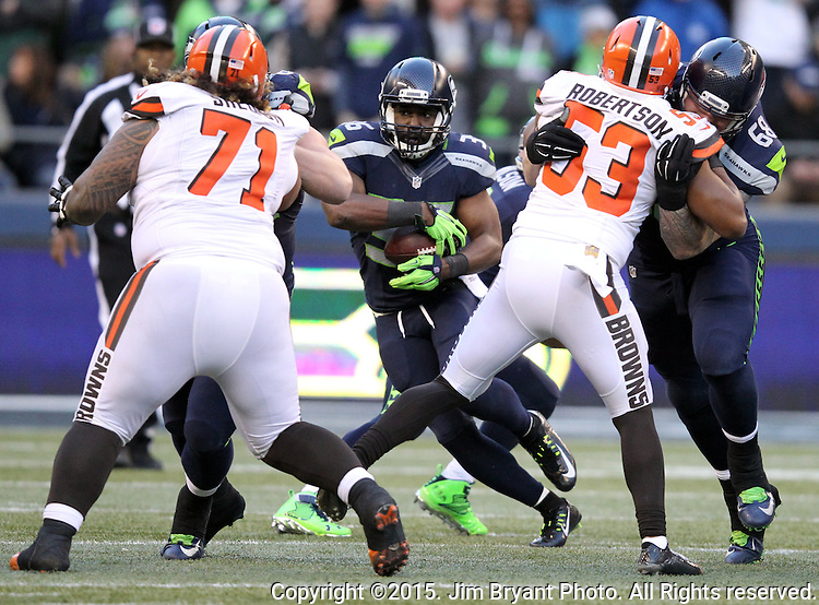 Seattle Seahawks, running back Bryce Brown looks for running room against the Cleveland Browns at CenturyLink Field in Seattle, Washington on December 20, 2015. The Seahawks clinched their fourth straight playoff berth in four seasons by beating the Browns 30-13.  ©2015. Jim Bryant Photo. All Rights Reserved.