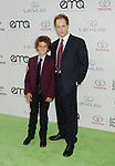 BURBANK, CA- OCTOBER 18: Actor Raphael Sbarge (R) and son Django Sbarge arrive at the 2014 Environmental Media Awards at Warner Bros. Studios on October 18, 2014 in Burbank, California.