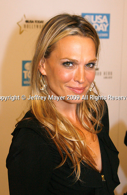 BEVERLY HILLS, CA. - November 10: Molly Sims arrives at the USA Today Hollywood Hero Awards at Montage Beverly Hills on November 10, 2009 in Beverly Hills, California.