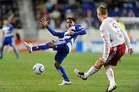 David Ferreira (10) of FC Dallas attempts to block a pass by Tim Ream (5) of the New York Red Bulls. The New York Red Bulls defeated FC Dallas 2-1 during a Major League Soccer (MLS) match at Red Bull Arena in Harrison, NJ, on April 17, 2010.
