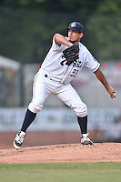 Asheville Tourists starting pitcher Helmis Rodriguez (33) delivers a pitch during a game against the Rome Braves on July 28, 2015 in Asheville, North Carolina. The Tourists defeated the Braves 3-2. (Tony Farlow/Four Seam Images)