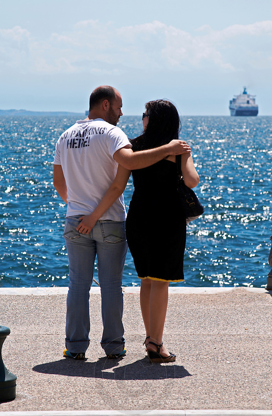 The waterfront. Romantic couple looking at the sea. Thessaloniki, Macedonia, Greece