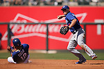 Los Angeles Dodgers' Kike Hernandez turns a double play past Texas Rangers' Rougned Odor during spring training game in Surprise, Ariz., on Saturday, March 26, 2017.<br /> Photo by Cathleen Allison/Nevada Photo Source